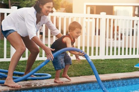 mom and son cleaning pool