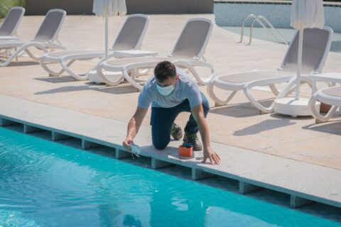 Man Testing Chemicals in Pool