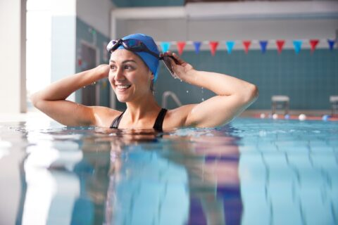 Woman Swimming For Exercise