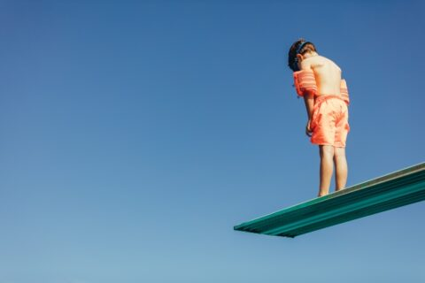 Young Boy On Diving Board